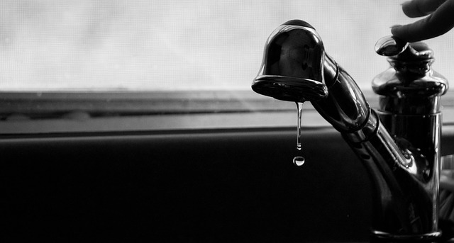 A photo of a dripping faucet
