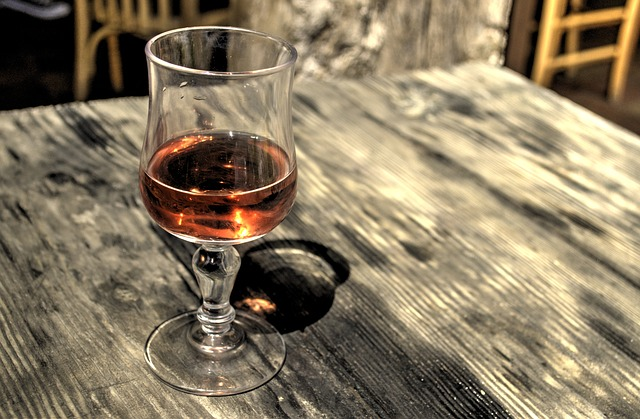 Photo of a wine glass sitting on a table