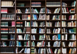 Several shelves of books in a library