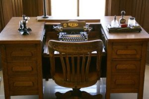 Old-fashioned desk and swivel chair